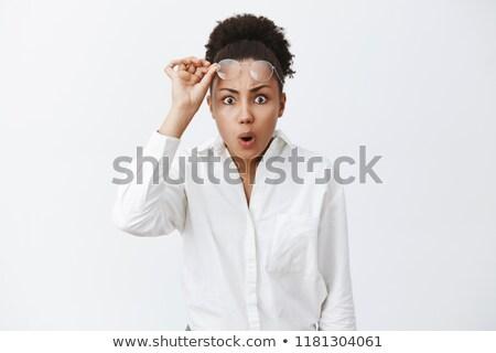 közelkép · portré · néma · tanácstalan · fiatalember · karok - stock fotó © stockyimages