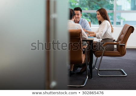 Stock photo: Asian business woman showing copy space.