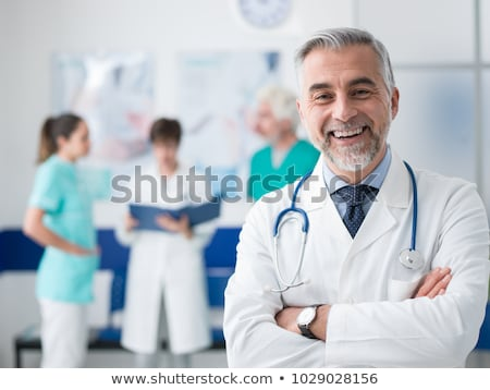 portrait of confident professional doctor in medical uniform in cabinet Stock photo © LightFieldStudios