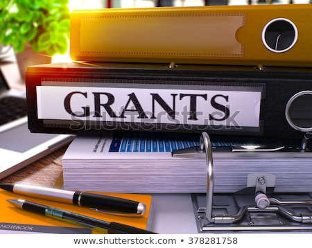Grants on Black Ring Binder. Blurred, Toned Image. Stock photo © tashatuvango