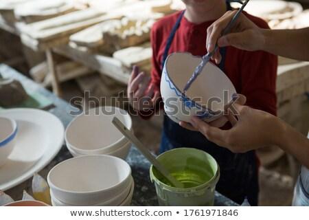 középső · rész · női · fiú · festmény · tál · cserépedények - stock fotó © wavebreak_media