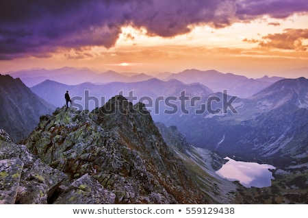 Hiker looking at the sunrise. Stock photo © IS2