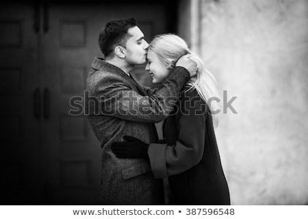 Newlywed couple kissing on city street Stock photo © IS2