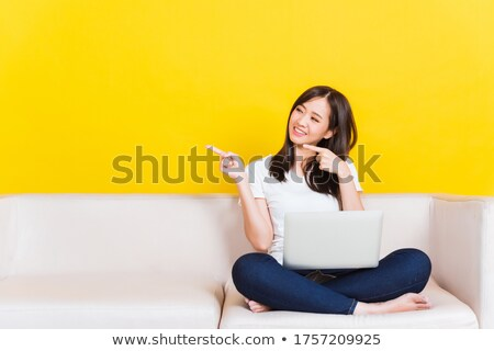 Portrait of young girl sitting on sofa Stock photo © IS2