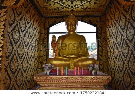 Budist heykel yandan görünüş küçük bronz bahçe Stok fotoğraf © craig