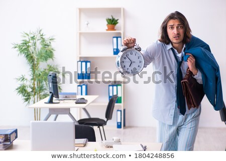 Zdjęcia stock: Employee coming to work straight from bed
