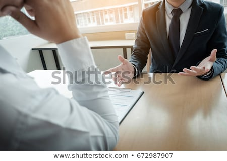 young man explaining about his profile to business managers sitt Stok fotoğraf © snowing