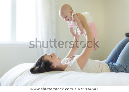 Portrait of parent with her 3 month old baby in bedroom Stock photo © Lopolo