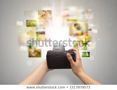 Hand captures life events with digital camera Stock photo © ra2studio