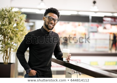 Image of young african american man standing with arms crossed i Stock photo © deandrobot