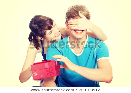 Surprising boyfriend with gift Stock photo © photography33