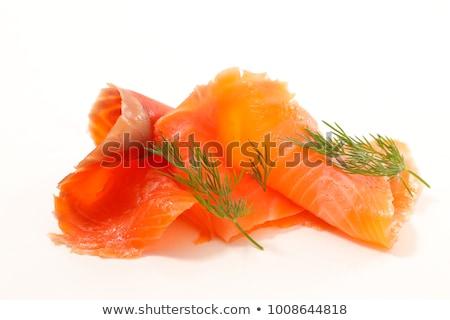 slices smoked fish background Stock photo © ozaiachin
