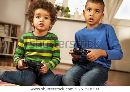 children playing handheld video games stock photo © photography33
