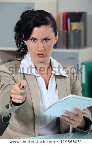 Stern receptionist pointing pen at camera Stock photo © photography33