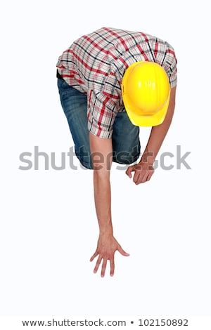 Tradesperson reaching to pick up a fallen object Stock photo © photography33