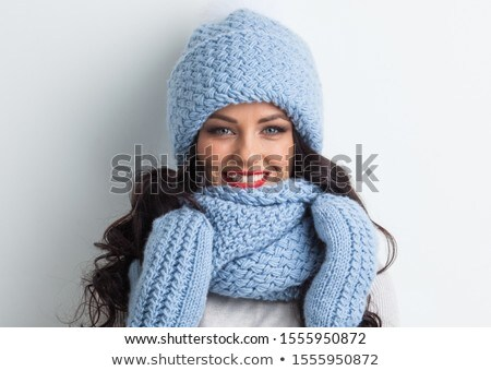 portrait of smiling young woman in gloves stock photo © acidgrey