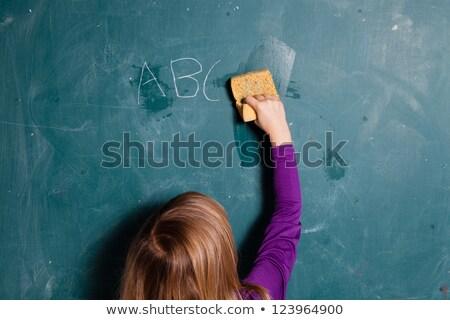 młoda · dziewczyna · Tablica · mokro · gąbki · litery · napisany - zdjęcia stock © ElinaManninen