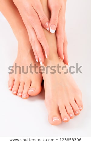 Well-groomed hands on female feet Stock photo © Nobilior
