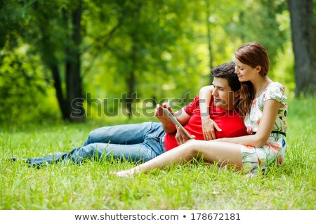 couple on grass with computer stock photo © photography33