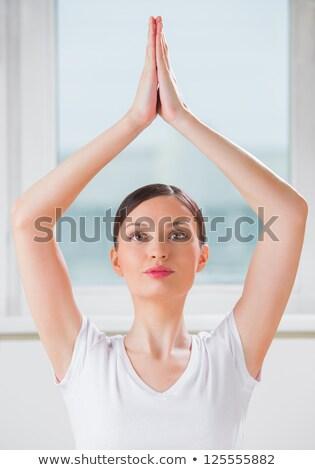 retrato · sorridente · mulher · jovem · ioga · mãos - foto stock © hasloo