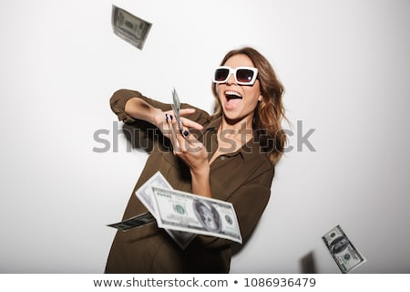 beautiful young lady with cash stock photo © aikon