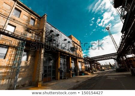 Kémény öreg elhagyatott ipari épület folyó Stock fotó © meinzahn