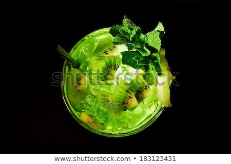 Green cocktail like mojito on dark background Stock photo © dariazu
