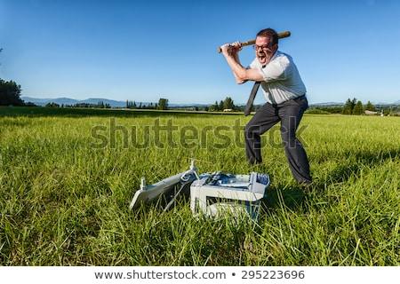 businessman - printer smash Stock photo © dgilder