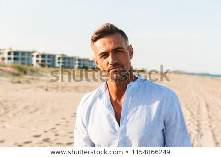 Handsome guy on the beach Stock photo © Anna_Om