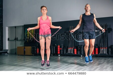 fitness instructor with jump rope Stock photo © dolgachov