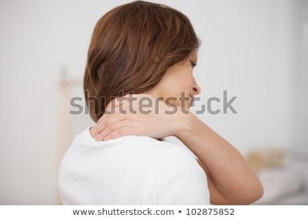 Morena tocante doloroso ombro branco mulher Foto stock © wavebreak_media