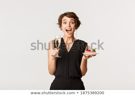 amazed woman holding glass of champagne stock photo © deandrobot