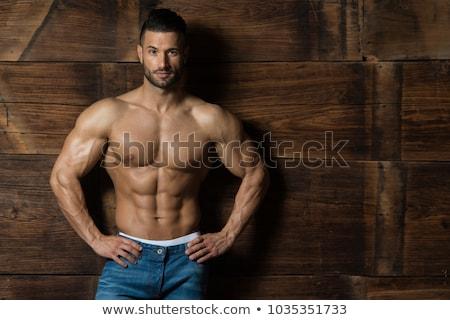 élégant bodybuilder jeans sexy corps Photo stock © konradbak