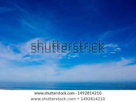 Cloud formation against blue sky. Stock photo © iofoto