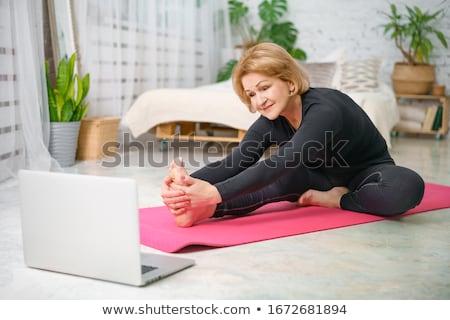 Pilates fitness donna allenamento donna fitness vetro Foto d'archivio © racoolstudio