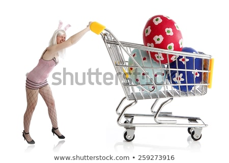 Easter bunny with colorful eggs in her shopping cart Stock photo © kb-photodesign