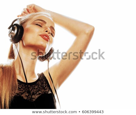 Stock photo: young sweet talented teenage girl in headphones singing isolated