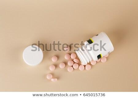 Marrom pílulas branco plástico garrafa bege Foto stock © ironstealth