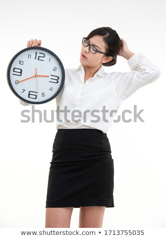 The young business woman with alarm clock on black background Stock photo © master1305