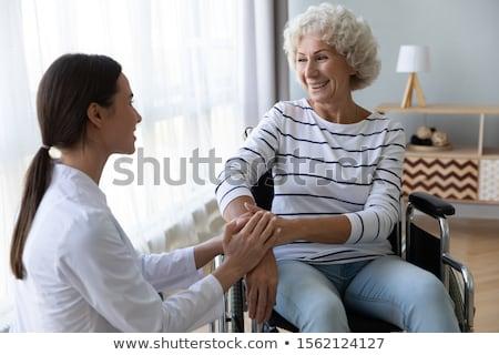 Doktor konuşma kıdemli kadın oturma tekerlekli sandalye Stok fotoğraf © wavebreak_media