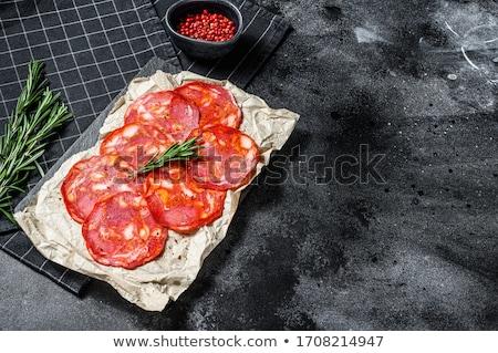 spanyol · chorizo · szeletek · piros · fűszeres · füstölt - stock fotó © digifoodstock