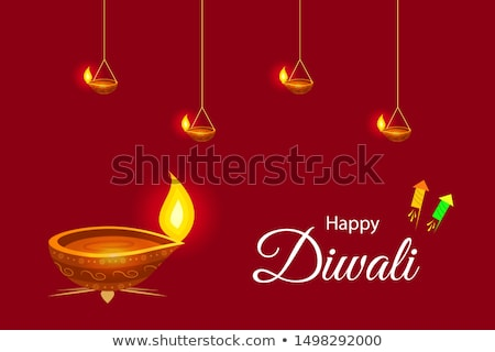 handing diwali lamp diya with floral background Stock photo © SArts