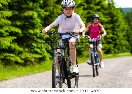 Children with bikes on country lane Stock photo © IS2