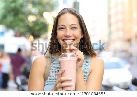 Girl drinking a milkshake Stock photo © IS2