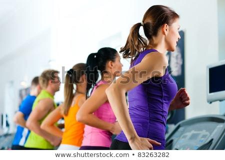 Fiatal nő testmozgás futópad tornaterem mosoly sport Stock fotó © boggy