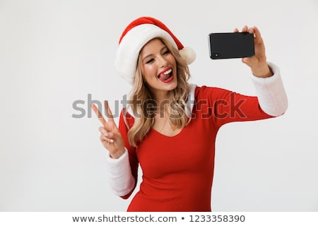happy young cute snow maiden take a selfie by mobile phone stock photo © deandrobot