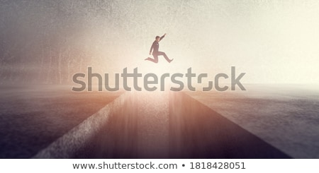 3d businessman overcomes an obstacle Stock photo © AlexMas