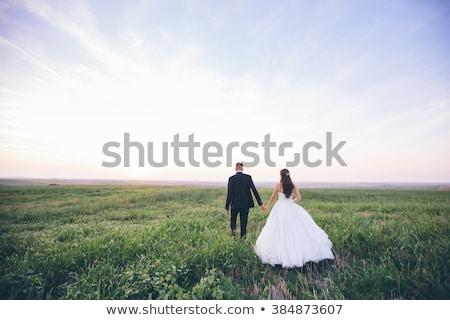 Bruid bruidegom natuur bloem bruiloft gezicht Stockfoto © ElenaBatkova
