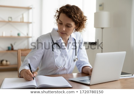 fiatal · nő · orvos · fehér · kabát · számítógép · gondolkodik - stock fotó © dolgachov