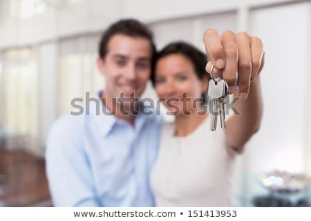 Stock fotó: Férfi · tart · kulcs · ház · házak · város